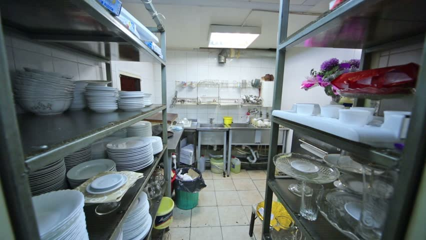 Kitchen At The Restaurant With Dishes Rack And Sink For Washing Stock ...