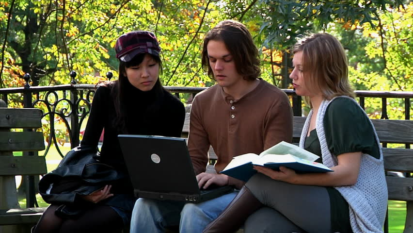 Students meet on campus to socialize and study. - HD stock video clip
