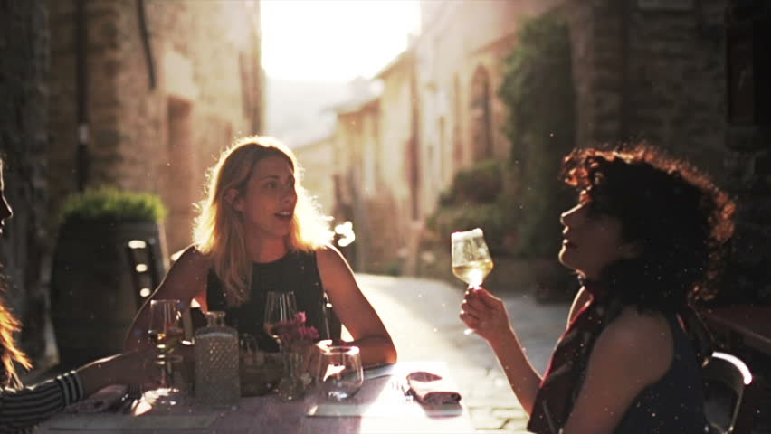 Women eating gourmet dishes in a elegant restaurant