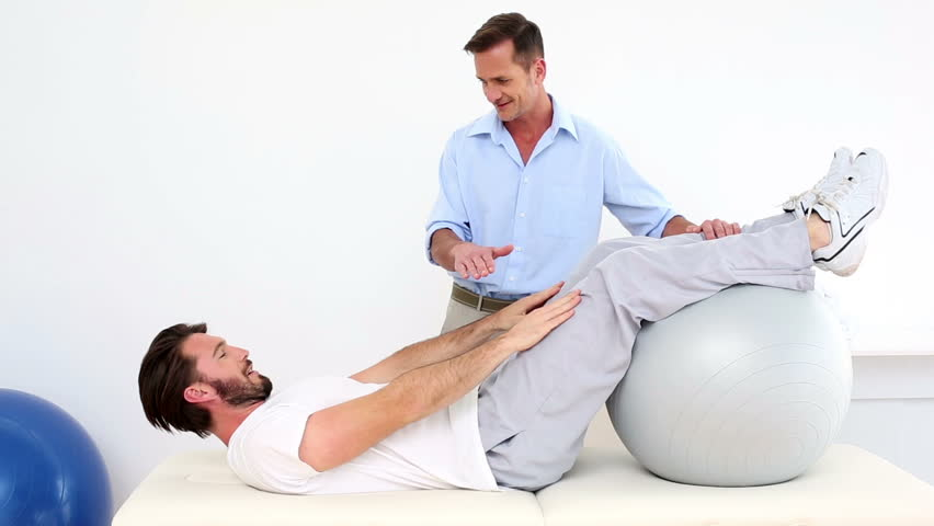 how to do a sit up on an exercise ball