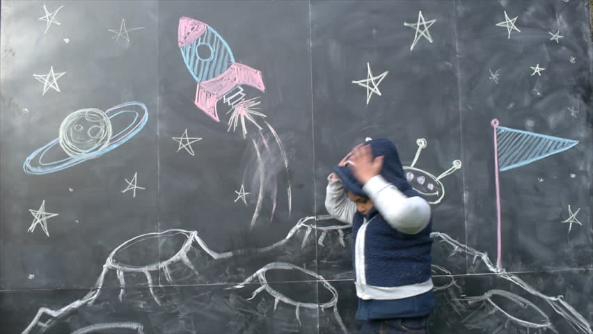 Cute Boy With A Space-Themed Chalkboard Drawing