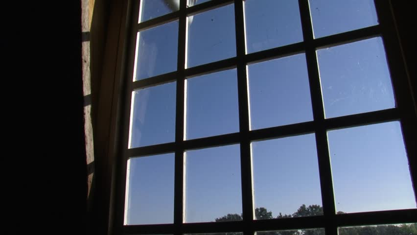 window view from a Dutch windmill + turning wicks in blue sky  - HD stock footage clip
