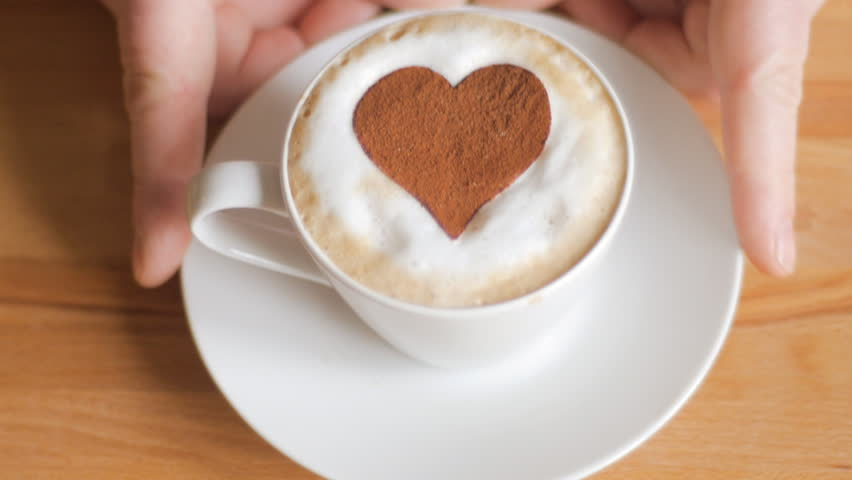 Valentine's cappuccino with heart in chocolate - HD stock footage clip