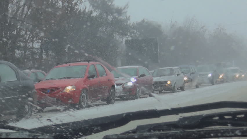 Driver Driving on Blizzard Snowstorm, Heavy Slowed Traffic, Snowing in Winter - HD stock video clip