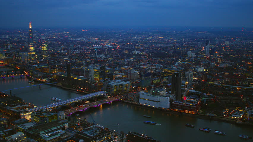 4K Aerial shot of Central London at night with view of London Eye, River Thames, The Shard, OXO Tower, Blackfriars Bridge, Tower Bridge