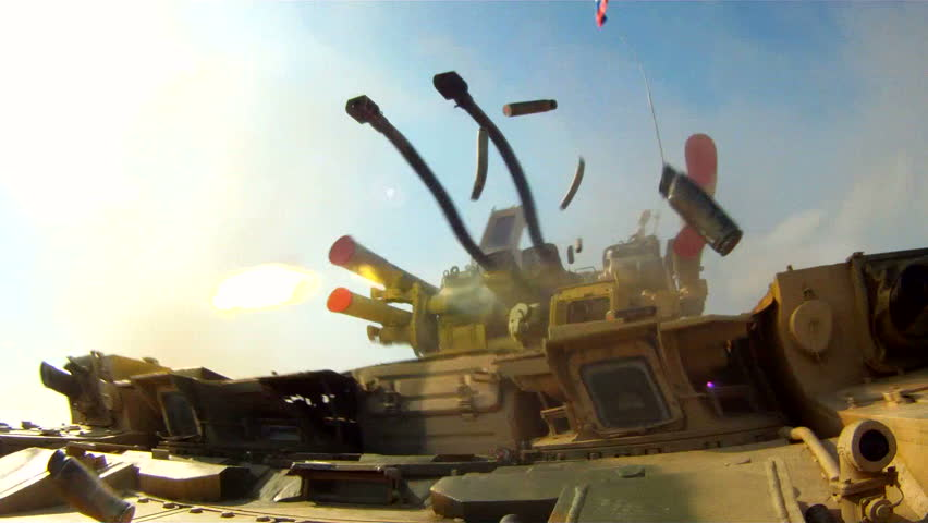 Russian army military field exercises.APC Terminator shooting with machine gun .Bullet Shells falls into the camera.Russian weapons at the landfill