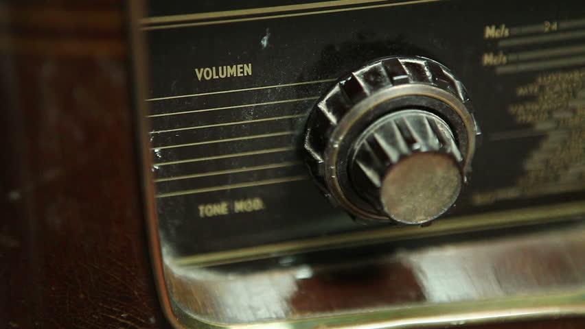Very old Retro Radio, Hand Raising volume, Close Up, Using shallow depth of Field  - Full HD 1920X1080