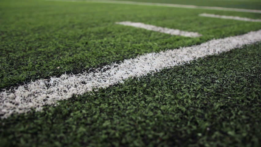 Close Up Of The Out Of Bounds Line On A Turf Football