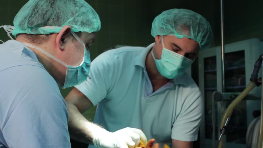 Multi Ethnic Medical Team Performing Operation In Hospital
