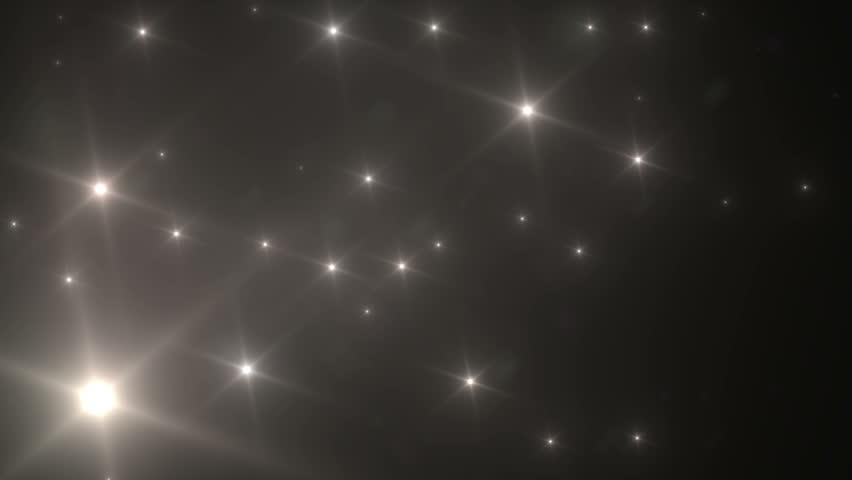 many light flashes effect over black background stock