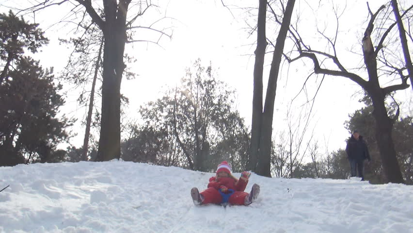 POV of a Child Sledding in Snow, View of Little Girl Playing, Accident while Sledging in Park in Winter
