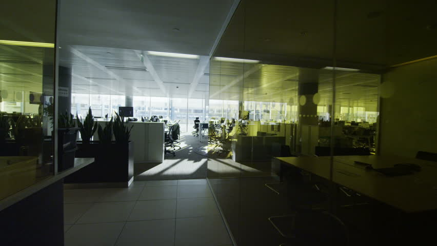 Interior view of empty office work stations in a large contemporary city office building. No people. #5700344