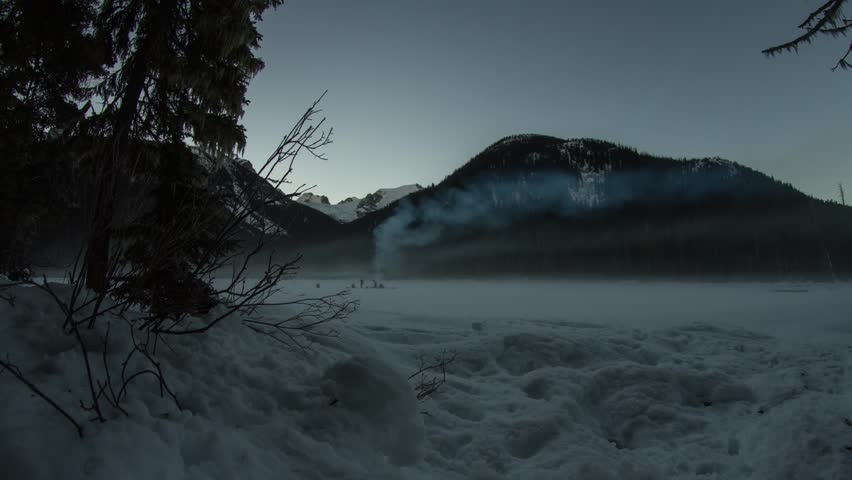 Motion dolly time lapse shot of people by the frozen Joffrey Lake in BC - HD stock footage clip