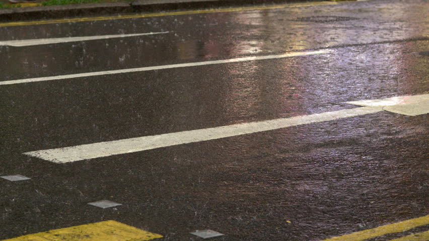 NS in slowmotion of a street under pouring rain in downtown of Hong Kong | Shutterstock HD Video #5735138