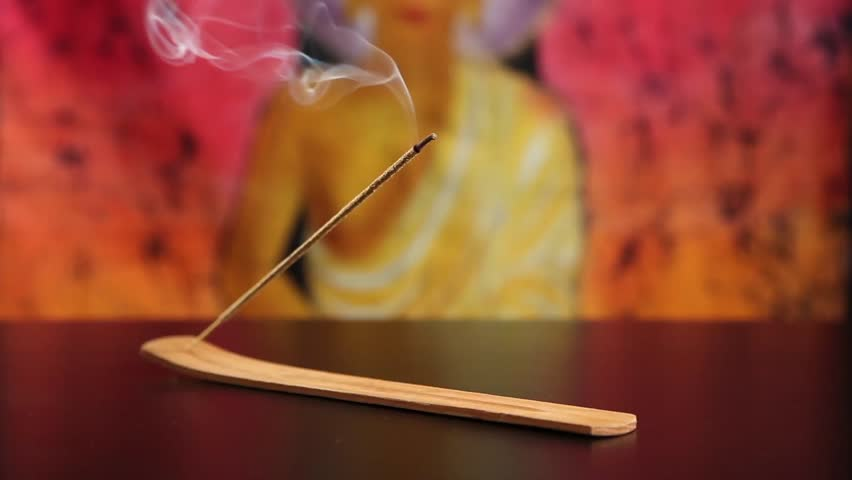 Burning incense stick with selective focus on combustion and smoke - HD stock footage clip