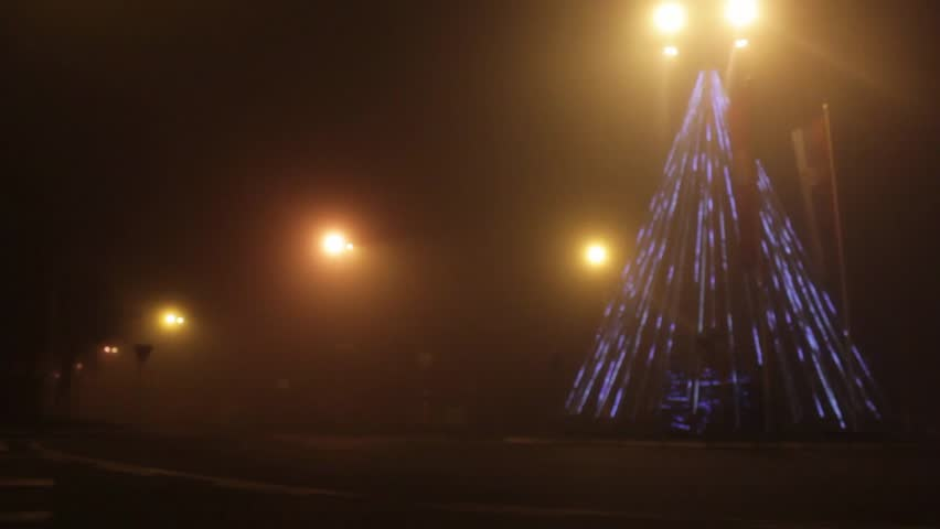 Outdoor Flood Lights Burn Out Quickly : Smoke rises to the street light fog descended on town