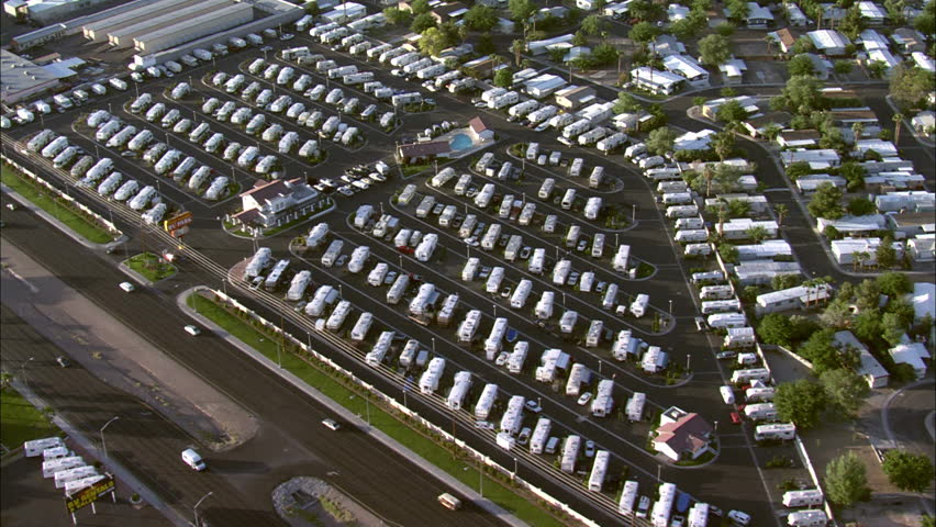 Las Vegas RV Park. A far view of an RV Park and several residential areas in Las Vegas, Nevada. Includes bustling streets with traffic. - HD stock footage clip