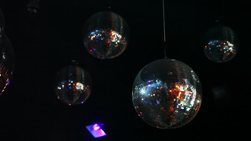 mirror balls and light lamp hang on ceiling in night club