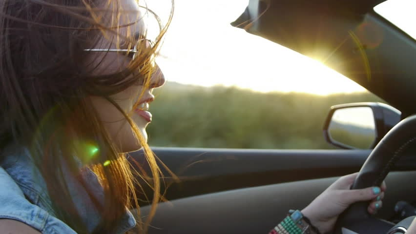 Profile Of A Beautiful Teen, Driving In Desert At Sunset