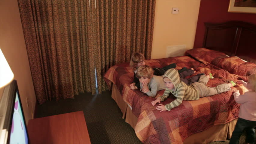 Children watching television in hotel room - HD stock video clip