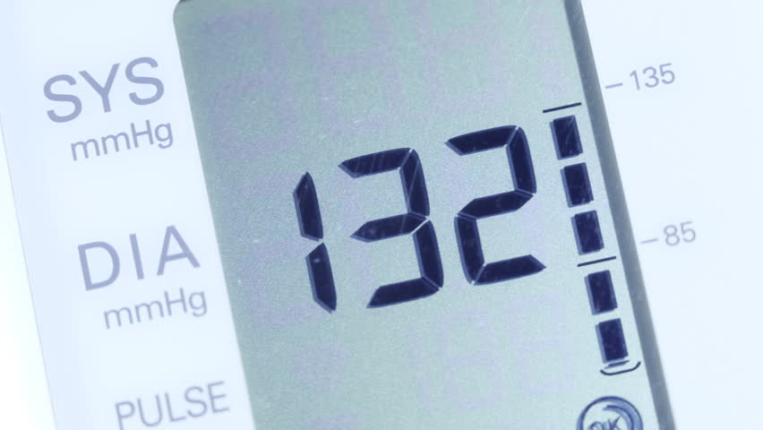 Blood pressure displayed on monitor close-up.