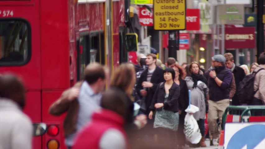 LONDON, UK - OCTOBER 8, 2011: Bus passes a crowded street.