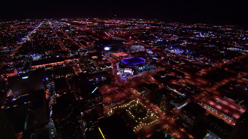 US Airways Center Arena Phoenix. Far view from US Airways Center in Phoenix, Arizona. Purple lights protrude from the rooftop, with the neighboring structures and busy streets also featured.