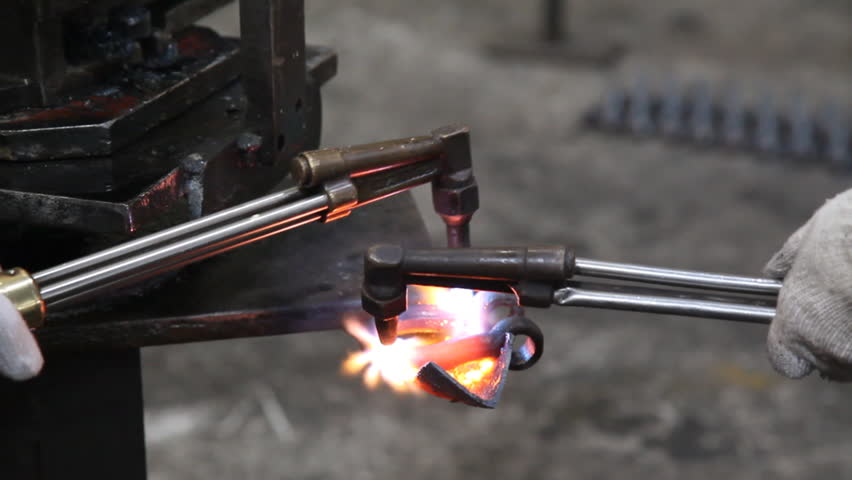 heating up steel by blow torch - HD stock video clip