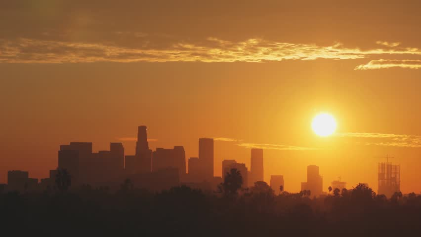 LOS ANGELES - CIRCA OCTOBER 2013: Time lapse shot of the sun rising over the Los Angeles skyline.