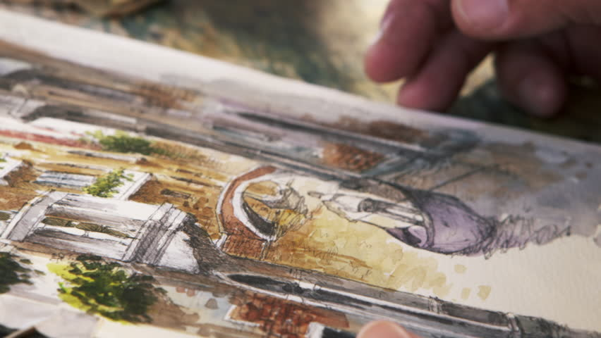 Close up shot of artist painting in details of a scene of a gondola on a canal