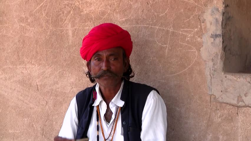 JAMBA - NOV 14: Unidentified Indian man smoking hashish on November 14, 2011 in Jamba, Rajasthan, India. Rajasthan has cultural traditions which reflect the ancient Indian way of life.  - HD stock footage clip