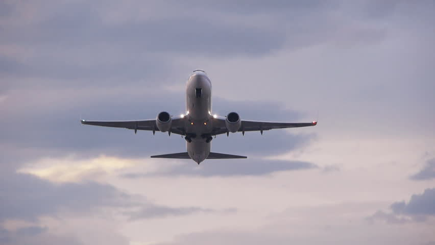 airplane taking off passing over head  at bologna airport,tracking shot,bologna airport 01/03/2013 17,45 italy