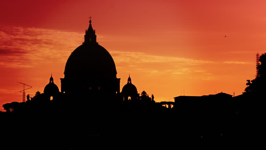 St Peter's Basilica silhouetted against a sunset - 4K stock video clip