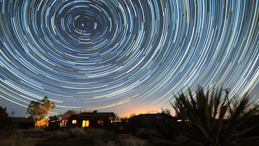 4K Star Trails Night Sky Cosmos Galaxy Time-lapse over Cabin. Sunrise from night to day in amazing high resolution at Joshua Tree National Park, California.  | Shutterstock HD Video #5860994