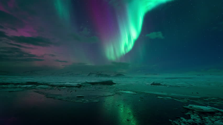 The Aurora Borealis (Northern Lights) reflecting on the Jokulsarlon Glacier Lagoon, Iceland