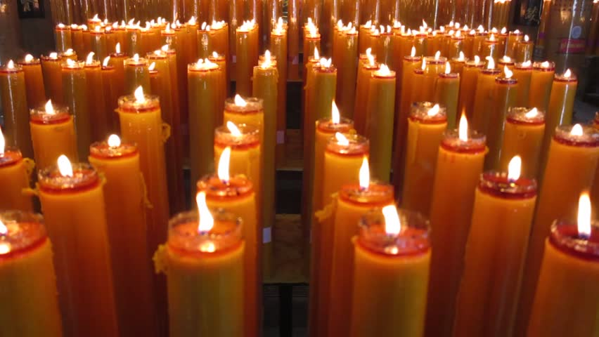Worship Golden light candles burning in temple Thailand - HD stock footage clip