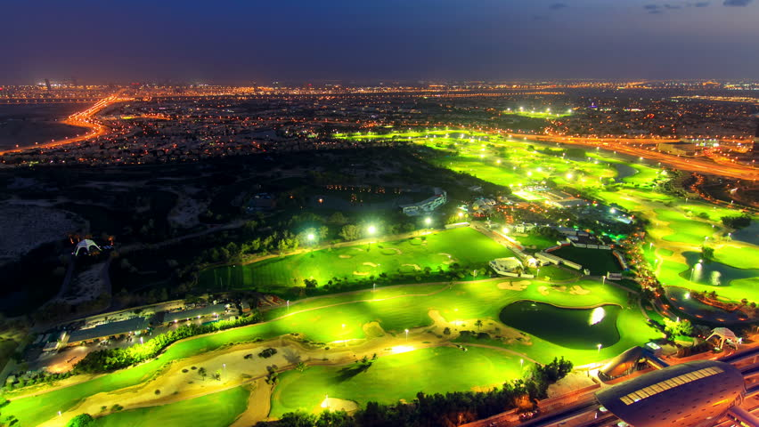 Dubai golfclub timelapse at night with view on the city and colorful night traffic - 4K stock video clip