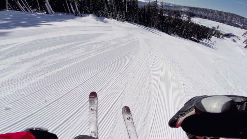 Fast Skier Rides Down the Snowy Slopes on a Pristine Day on the Mountain with Clear Skies and Snowy Trees on the Side with Sound HD 1080 Video Head Mounted POV Camera Point of View