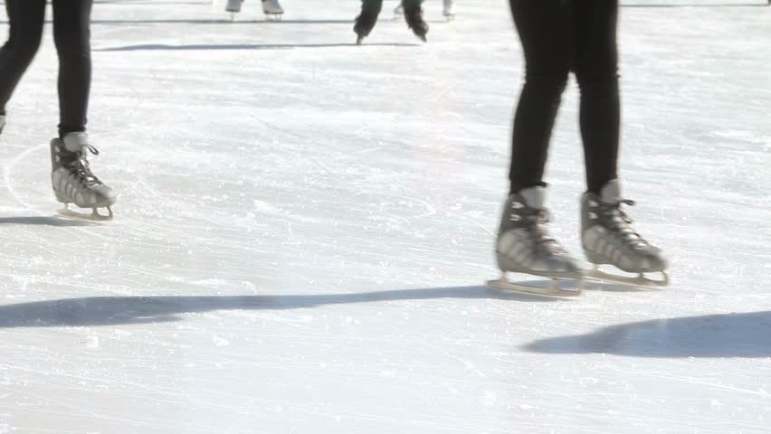 People ice skating, anonymous ice-skaters feet and legs  - HD stock footage clip