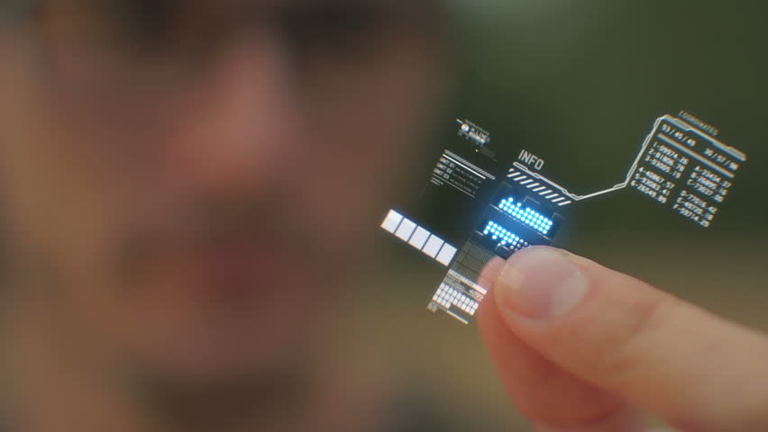 Shot of a person holding a computer processor with a holographic interface.