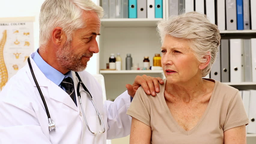 Doctor talking with his patient in his office at the hospital - HD stock footage clip