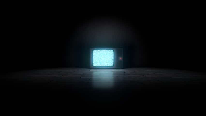 Old TV on the floor. Camera enters the Tv with alpha channel static at the end.