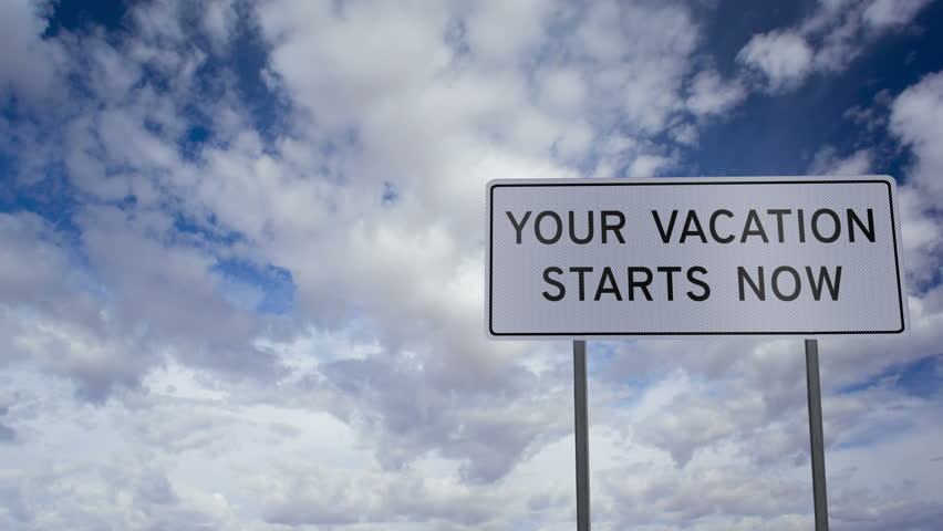 Road Sign With The Words YOUR VACATION STARTS NOW With A