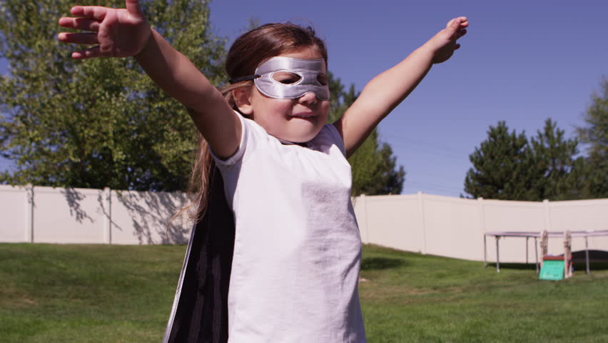 Young girls dressed as superheroes playing outside - 4K