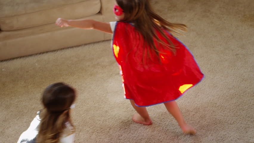 Young girls dressed as superheroes playing at home - 4K | Shutterstock HD Video #5949671