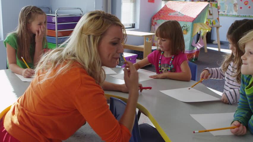 Teacher and little children at pre-school - 4K - 4K stock video clip