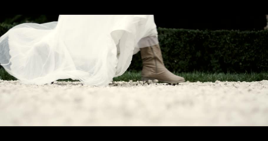 Beautiful bride running in her wedding dress