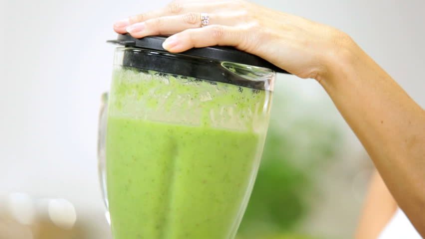 Hands close up female preparing workout session making fresh organic vegetable juice as part modern healthy lifestyle diet - Female Hands Blender Fresh Fruit Juice After Workout