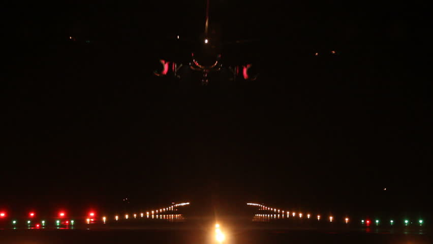 Airliner landing at an airport in the night