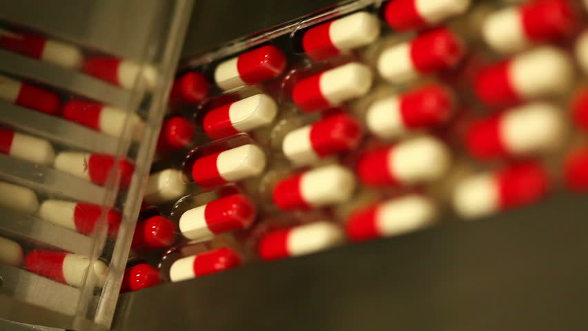 Drug Production. Pharmaceutical machinery for medicine production Pills